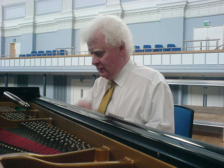 Phil preparing a Steinway grand piano at Birmingham Town Hall