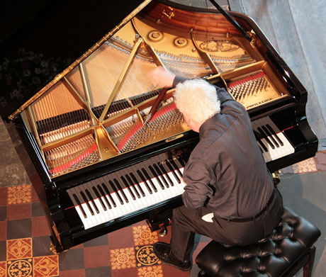 Philip Kennedy tuning a piano for the Hay Festival